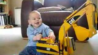 vuclip Evan playing with a toy digger