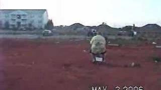 Fat kid on Moped