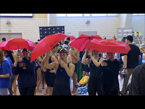 Swimmers Honor Sick Teammate With Sea of Red Umbrellas