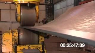 Production of a saddle shaped panel