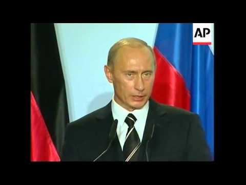 WRAP Funeral for slain Russian journalist Anna Politkovskaya, Merkel, Putin comments