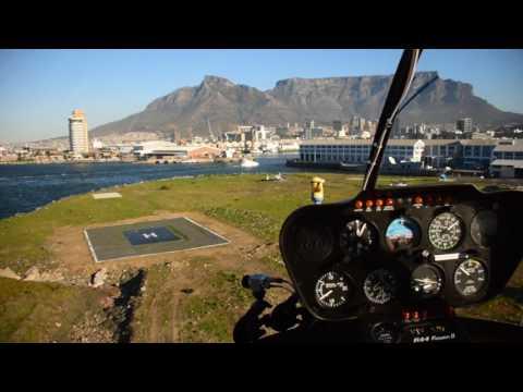 Robinson R44 Raven II ZS-RIZ Landing in Cape Town Waterfront Helipad