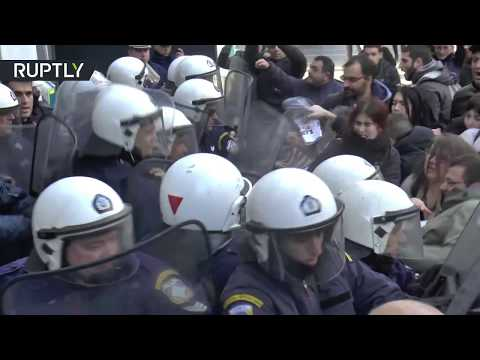Greek protesters clash with police demanding to stop property auctions