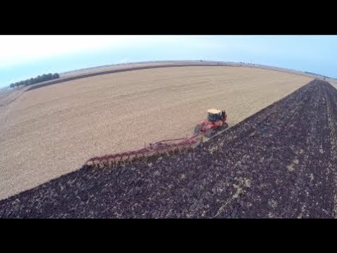 Versatile 550 Delta Track tractor pulling a Salford 14 bottom plow