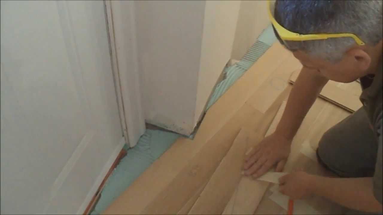 How to install glue down hardwood floors over concrete in for Hardwood floors uneven