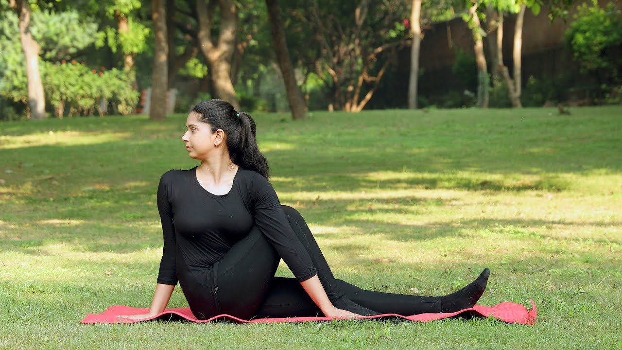 A Young Girl Practicing Vakrasana Yoga Asana In A Park Indian Stock Footage Knot9 Youtube