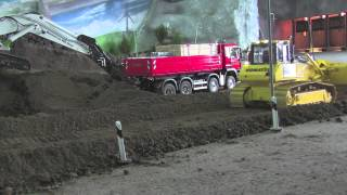 RC DOZER KOMATSU D65 LEVELLING SOIL AT THE CONSTRUCTION SITE