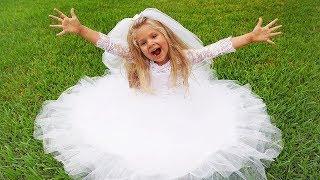 Diana experimenta um vestido de noiva