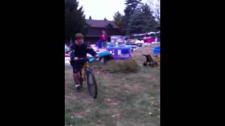 Kid eats shit on bike jump( no balls anymore)