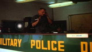 Area Command Officer talks on phone inside Military Police headquarters in Saigon...HD Stock Footage
