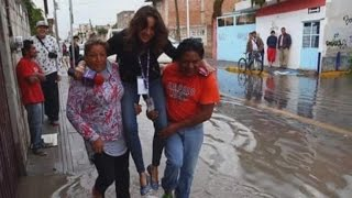Download TV Reporter Fired After Being Carried Over Floodwaters to Keep Shoes Clean Mp3 and Videos
