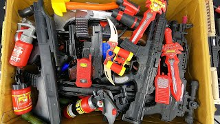 Box  of Toy Guns and Realistic Weapons and Ammunition Consisting of Red Color Eq