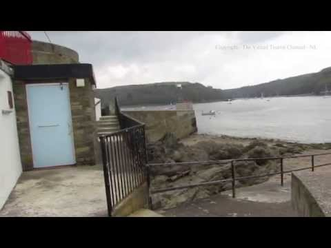 Polruan Ferry Leaving Whitehouse and the Old Shelter in Fowey Cornwall