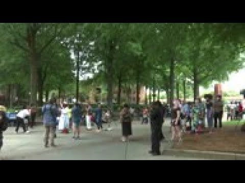 mourners-gather-outside-of-brooks-funeral-service
