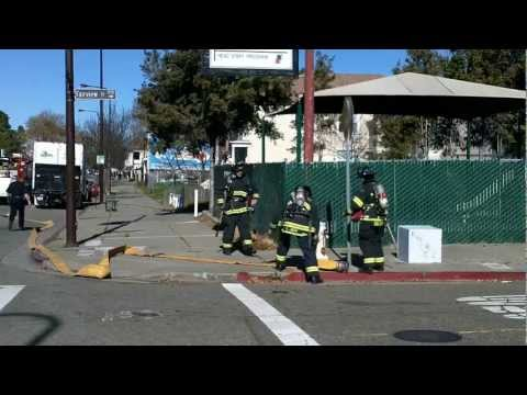 Firefighters open hydrant. Fire at Sacramento St, Berkeley, CA.  Jan 2013