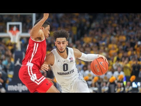 Marquette Courtside - Marquette outlasts Wisconsin in overtime, 74-69