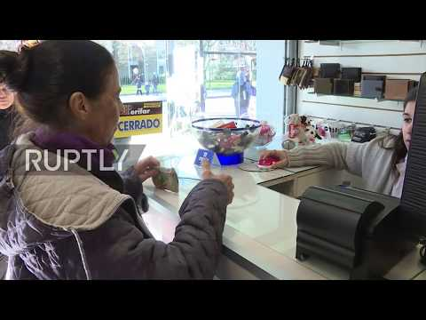 Uruguay: People queue up outside pharmacies, after they start selling cannabis