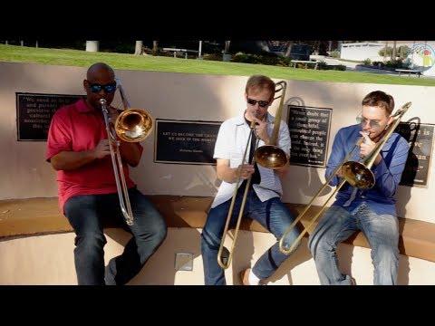 3 Trombone Players Having Fun