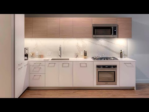 A West Loop 1-bedroom plus den model at the stylish new EMME apartments