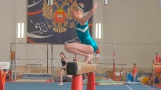 girl gymnasts performance gymnastics balance beam at competitions in Russia
