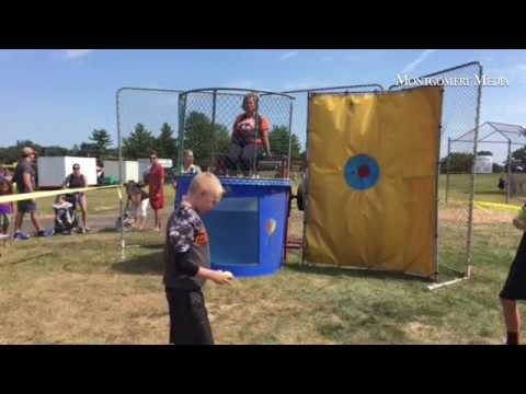 Will these Falcon ball players successfully dunk Makefield Elementary School Principal Donna McCormi