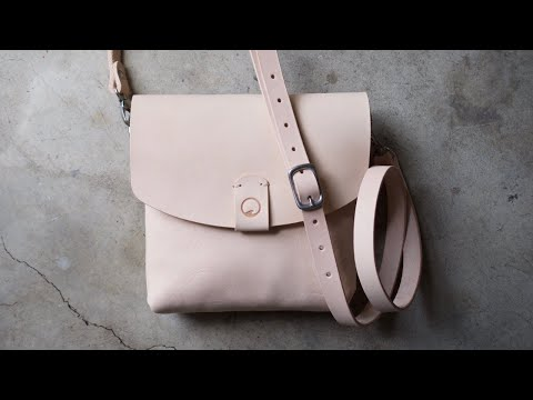 The making of a crossbody purse in natural Vegetable Tanned leather.