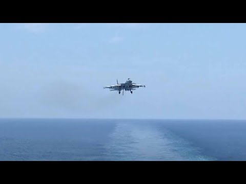 How do J-15 fighter jets take off from Liaoning aircraft carrier?