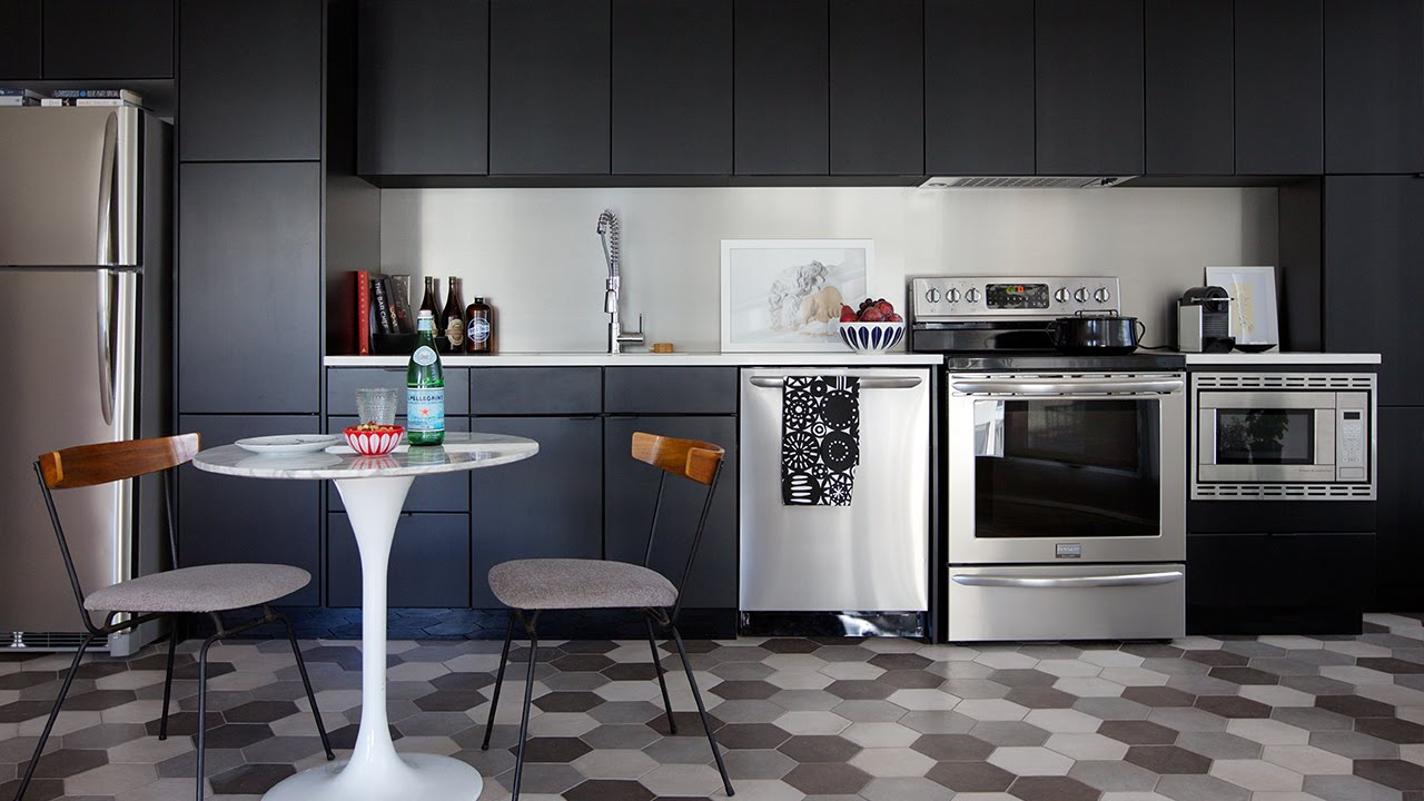 MAKEOVER  A Small Condo Kitchen With Black Cabinets