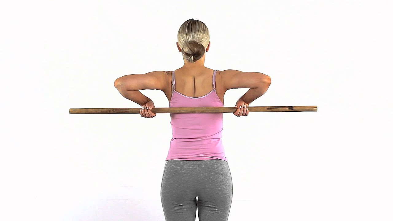 Improve internal rotation of your shoulder using a dowel ...