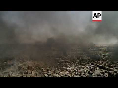 Drone footage shows smoke over Mosul Old City