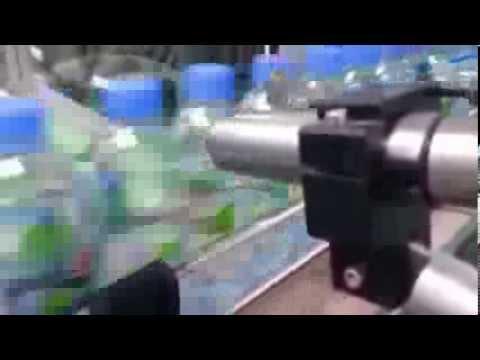 Date Coder onto PET bottles for drinking water by Linx CIJ inkjet printer