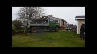 Toyota to the rescue when the dump truck gets stuck in the yard