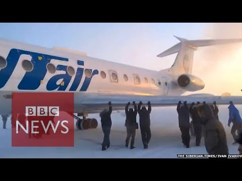 People power: Passengers push 'frozen' plane in Siberia