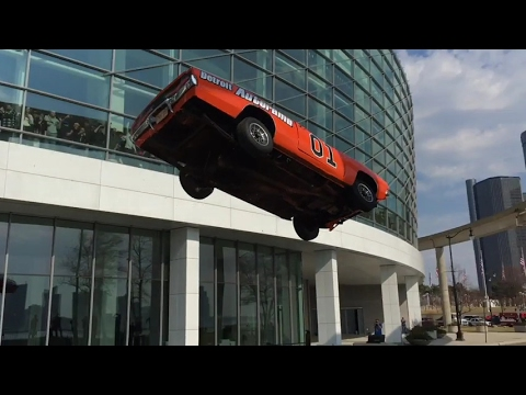 Slow motion General Lee stunt jump in Detroit at Autorama