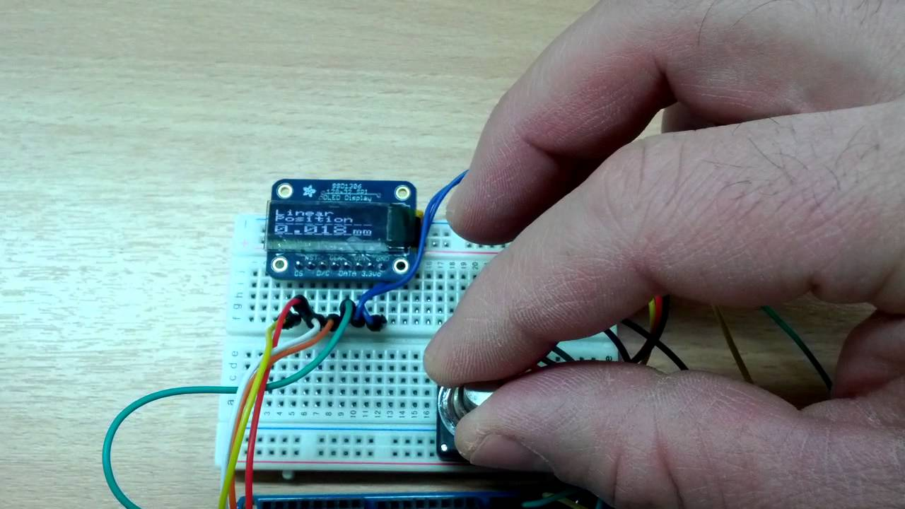 Arduino working with optical encoder and Adafruit OLED by Adam Woolhead