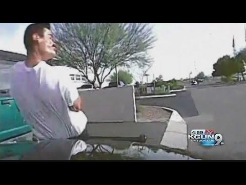 Marana Officer uses car to hit gunman---video goes worldwide