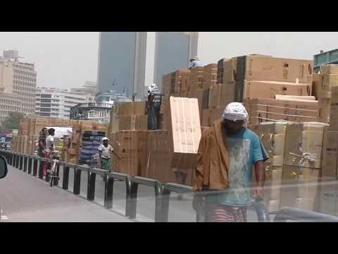 Worker carrying refrigerator on his back in Dubai Creek 19.07.2017