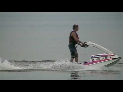 kelly illies wipes out on a kawasaki 550sx on otter tail lake