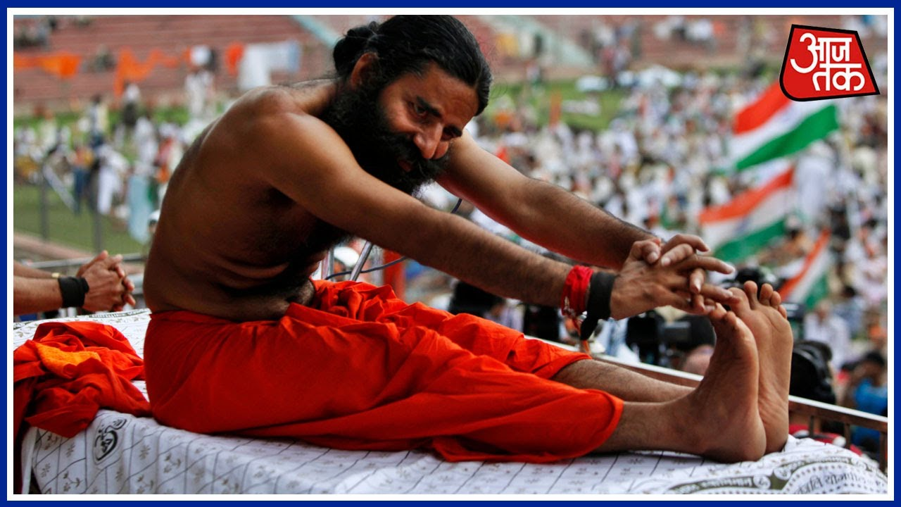Ahead Of Yoga Day Baba Ramdev Practices Yogasans In Ahmedabad