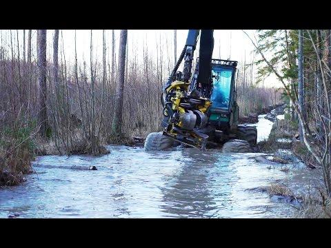 Timberjack 1270D harvester in winter forest