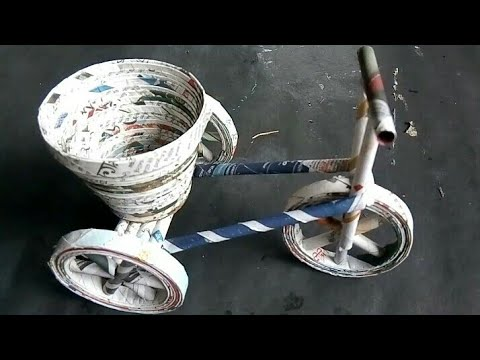 How to make newspaper cycle/DIY newspaper cycle decorative piece/Best out of waste newspaper craft .