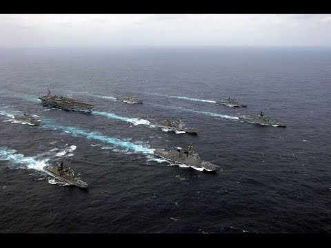 Carrier Strike Group & Expeditionary Strike Group Sail In The Philippine Sea