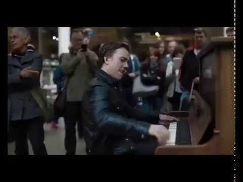 henri's boogie: Henri John Pierre Herbert 'dazzles' the crowd at London St Pancras with an impromptu performance on the public piano.  Full HD version here:   https://www.youtube.com/watch?v=h86nJUHrJ1E  For more information or to contact Henri go to: http://www.henriherbertmusic.com  And for more info about The Jim Jones Revue, please go to: http://www.jimjonesrevue.com   This video is being managed exclusively by Newsflare. To use this video for broadcast or in a commercial player go to: http://www.newsflare.com/video/13429/other/henris-boogie or email: newsdesk@newsflare.com or call: +44 (0) 8432 895 191  UPDATE: Due to several comments asking for a decent quality version of this clip, I'm pleased to offer the full HD version for your viewing pleasure.   I uploaded the original as a low bit rate, low resolution quickie, due to having a lousy internet connection where I was at the time. A big regret now, given that the clip went crazy viral - but how was I to know??  So here it is, (link below) in full HD 1080p glory, along with a slightly remixed audio - a little more of the ambient camera sound, because the disbelievers out there are convinced this was over-dubbed, somehow. As well as the camera built in (rubbish) audio, I placed a Zoom H4n stereo recorder just behind the piano to record good quality sound with less of the background noise audible, to later sync in post production. This resulted in also picking up the sound of broken strings inside the piano, which many people are convinced is the sound of a hidden percussionist somewhere, playing a hi-hat, and therefore it must be an overdub fake studio recording setup or something!  Well, it ain't.  https://www.youtube.com/watch?v=h86nJUHrJ1E