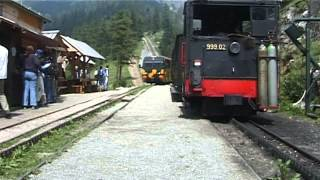 Schneebergbahn – cogwheel steam train at middle station waiting for oncoming diesel train