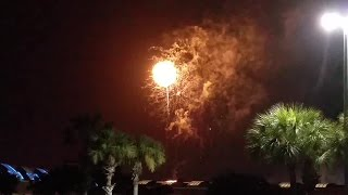 Lightning strikes over fireworks show in Tampa