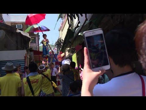 Hovering kids go political in Hong Kong festival parade