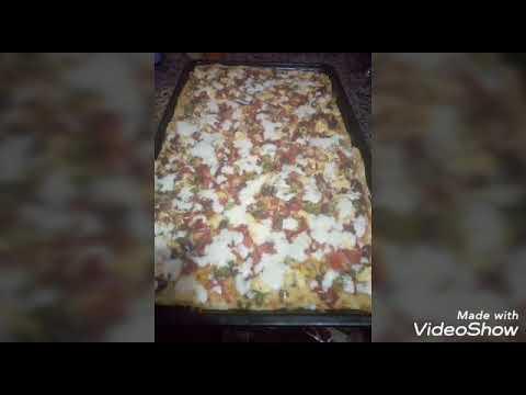 صورة  طريقة عمل البيتزا 👍👍طريقه عمل البيتزا العائلي سهله وبسيطه👌👌 طريقة عمل البيتزا من يوتيوب