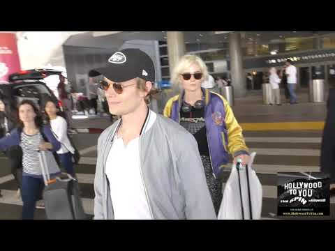Alfie Allen with girlfriend Jaime Winstone talks about working on Game Of Thrones while arriving at