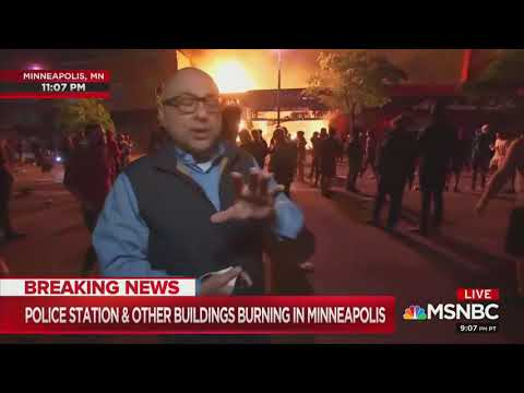 """MSNBC reporter in front of burning building: """"mostly a protest"""""""