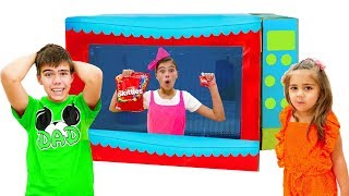 Nastya and Artem pretend play with toy microwave
